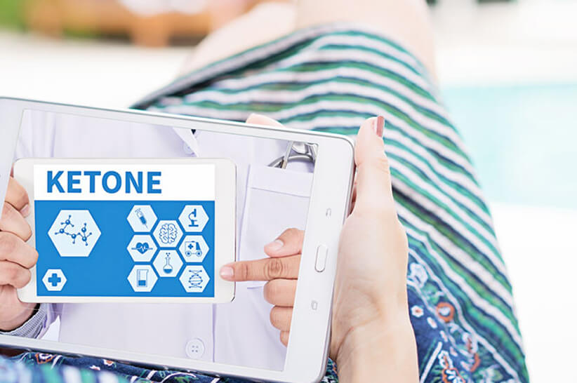 woman_checking_ketone_article_on_tablet